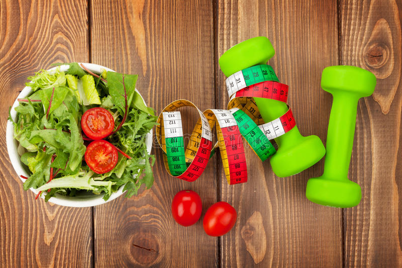 dumbells-tape-measure-healthy-food-fitness-health-over-wooden-table-47436977
